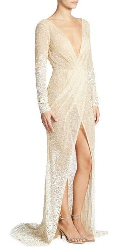On SALE at 40% OFF! long sleeve beaded gown by BERTA. A plunging V-neckline details this radiant beaded gown. Deep V-neck. Long sleeves. Front slit. Concealed back zip clo...