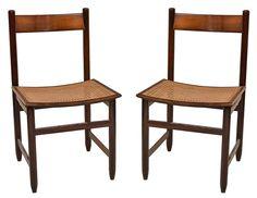 SERGIO RODRIGUES - Conjunto com seis cadeiras Lucio Costa em jacarandá maciço com assentos recurvos em palhinha.