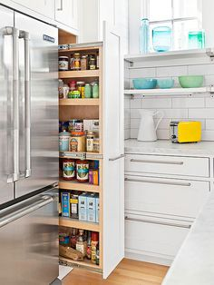 Add pull-out pantry cabinets to boxed in refrigerators to utilize every inch of the extra deep space.