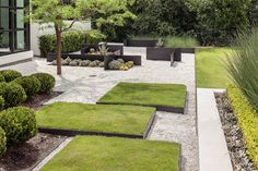 """enochliew: """" Garden by Exterior Worlds Instead of the conventional stepping stones, this garden incorporates large lawn stepping pads. """""""