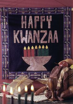 This banner features the kinara, a seven-branched candleholder that symbolizes the African people and continent.