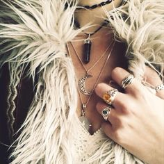 ...all of it.every piece of jewelery-not,for me,worn all together like that-and the jacket/top too-my style,perfectly...§