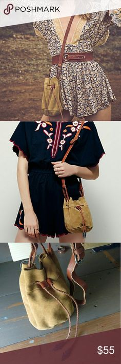 Free people Easy Rider suede bucket bag Super cute! Got this free people suede bag in black and this color..I foresee myself using the black more so I'm putting this on Poshmark until someone buys this or I decide to use it  still available online at full price, u can save some money here bc no tax and cheaper shipping. will run u about $85 online with tax & shipping! Real suede body and real leather straps. Open small pocket inside with cute Paisley pattern. Inside not lined, just full…