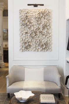 A seating area under a stunning contemporary art piece seduces customers into lingering. Our #CM5thAve store's decor feature from @One Kings Lane https://www.onekingslane.com/live-love-home/club-monaco-decorating-ideas/