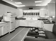 "May 3, 1955. ""Model kitchen in Chicago showroom. Advertisement for Crane fixtures."""