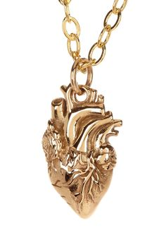 """Anatomical Heart Necklace by Jami   Details: - 24K gold plated and bronze anatomical heart charm necklace - Lobster clasp - Approx. 18"""" chain length - Approx. 0.75"""" L x 0.25"""" W charm - Made in USA Materials: 24K gold plated brass, bronze Everyone needs a heart! Great gift love"""