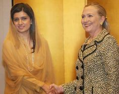 TOKYO, JAPAN, JUL 08: Pakistan Federal Minister for Foreign Affairs, Hina Rabbani Khar shakes hands with US Secretary of State, Hillary Clinton during a meeting.