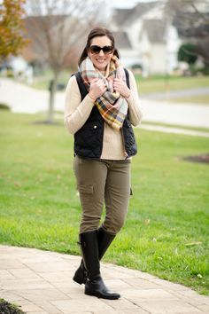 This is the perfect outfit for a chilly fall day spent outdoors: down vest, wool turtleneck, riding boots and blanket scarf.