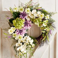 Our faux floral wreath boasts pretty pastels and lush greenery in an asymmetrical design that seems to enhance the engaging surprise that spring has arrived. And it& here to stay—on your door, mantel or tabletop—for as long as you want. Front Door Decor, Wreaths For Front Door, Door Wreaths, Grapevine Wreath, Yarn Wreaths, Fabric Wreath, Tulle Wreath, Burlap Wreaths, Front Porch