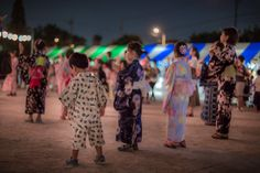 Kids dressed in yukata at a summer festival in Japan.