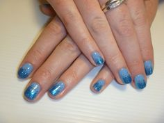 Blue Gelish gel polish on natural nails and blue glitter