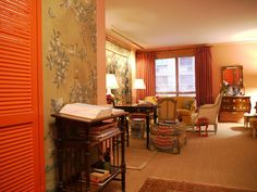 maureen footer studio apartment--layout, use of space, color palette, chinoiserie wallpaper, layered rugs