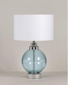 Group ID: L432054 Group Name: Reece Group Style: Metro Modern  Blue glass and chrome finished metal table lamp Drum shade On/off switch Type A light bulb 100 watts max or CFL 26 watts max