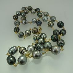 too much fun!  Handmade Natural Baroque Tahitian Pearl and 18K by OceanusJewelry, $1900.00