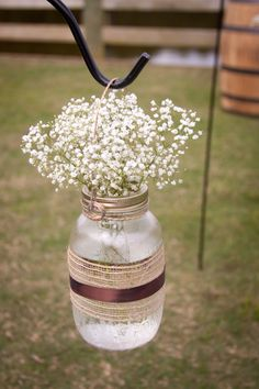 Pepper Plantation Charleston, SC Fall Wedding Flowers Babies Breath in masons jars with burlap and satin ribbon accents for aisle