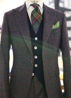 "landerurquijo: "" A Peak lapel, one button single breasted, and different types of plaid fabric matching with a blue cardigan"", / Solapa en pico, un solo boton, y diferentes tipos de cuadros combinando con un cardigan azul"", """