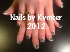 Tammy Taylor Pink and White Glitter Acrylic with Black flowers, silver glitter lines, and rhinestone centers.