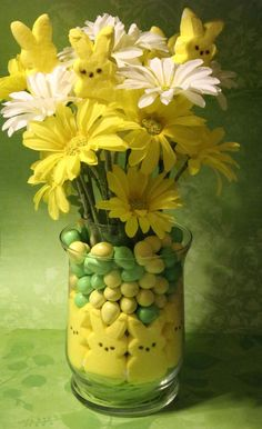 Easter centerpiece - There is a jar in the middle that holds the flowers. The Peeps and Reese's eggs are filling the space between the jars.