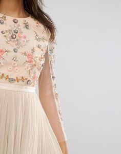 Delicate Floral Embroidery on aPink Lace Dress  The Prettiest Tea Dress with embroidered flowers, lace, and creamy pastel tulle is everywhere on Pinterest and I had to track it down. It's delicate, feminine, ladylike, and just so pretty! This magical pink concoction sparkles in the light and reminds me of princess tea parties. …