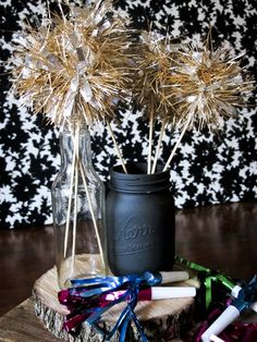 Faux sparklers. All you need is Xmas garland, Hot Glue gun and kabob sticks. Cut the garland and hot glue it to the stick.