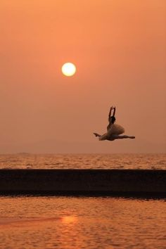 Leaping into the sunset. Gorgeous!