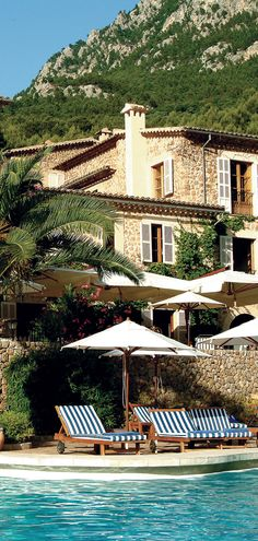 Sit poolside in #Spain within the foothills of the Tramuntana Mountains.
