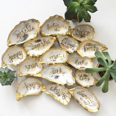 Gold oyster shell place cards for SF Wedding | www.prettypleasecalligraphy.com