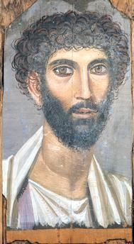 Portrait of a pale man in a lilac cape |  Late 2nd century. Wood. One of the Fayoum portraits, funeral portraits in Roman Egypt in the 1st–3rd centuries AD