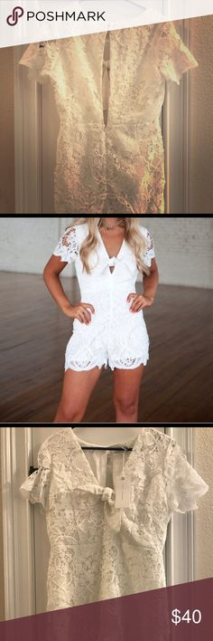 White romper White romper size large , floral design with open back Dresses