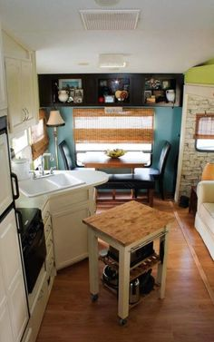 Couple Renovate 5th Wheel Travel Trailer into Tiny Home Photo. LOVE the Light kitchen cabinets, even the panels on the freezer and fridge have been painted. The 'just right' rolling cart with storage!