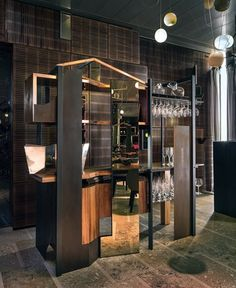The waiter's stations are made from steel, copper, timber and mirror.