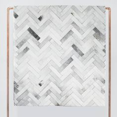 Hand-stitched in a herringbone design, each individually selected cowhide takes on a modern, minimalist look in this rug, crafted by artisans in…