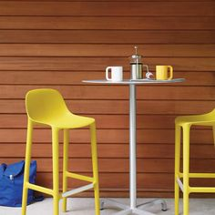 Emeco Broom Stools made from 75% waste polypropylene and 15% reclaimed wood and 100% aluminum Cafe Tables. #emeco