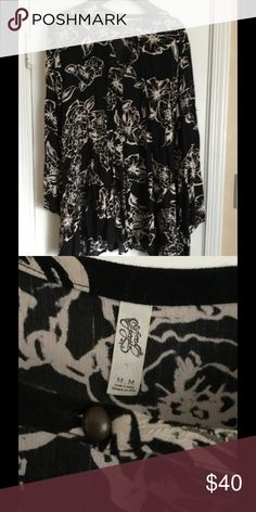 FREE PEOPLE BABY DOLL TUNIC Baby doll tunic black with white flowers. Long sleeved. Crepe like fabric, flowy. Fits up to size 18 Free People Tops Tunics