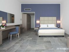 Hotel restoration project - Hotel Villa Borghi in Italy with stone look tiles as flooring by Floor Gres.  #restoration #project #new #renovation #floor #tiles #stone #grey #laying #creative #modern #style #Italy #madeinItaly #ceramics #quartzite #indoor #stoneware #porcelain #hotel #room #guest-room #bed #comfortable