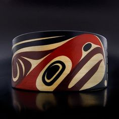 "Steam-bent Wood Bracelet by Steve Smith. Thunderbird and Bear. 1 3/4"" x 5 1/2"", $400.00 CAD. Available at Lattimergallery.com."