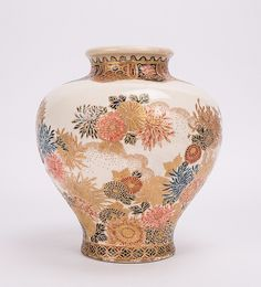 JAPANESE GOSHU SATSUMA VASE WITH FLORAL SCENE - 	Meiji period, 19th century; 8 in. h