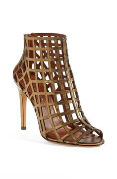 Gold and gladiator - super cool heeled cage sandals.