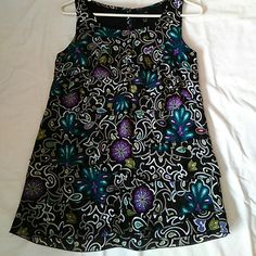 "Ruffle ""Nicole Miller"" Sleeveless blouse. Ruffled pattern in front. Floral pattern of black, teal and purple. Great with dress slacks or jeans. Re-poshed..didn't fit me. Nicole Miller Tops Blouses"