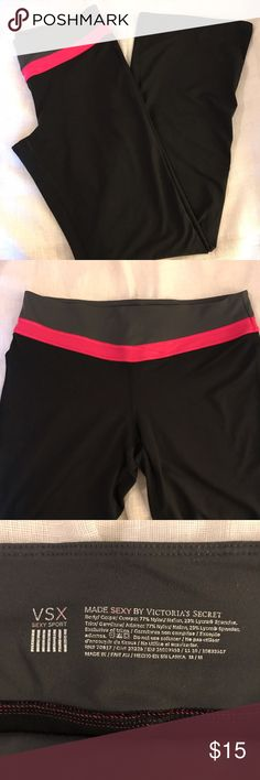 Victoria's Secret Sport Flare Workout Pants Made Sexy Sport by Victoria's Secret. Flare leg workout pants. Nylon and Lycra. Pocket on waistband. Minor wear on bottom of pant leg and pilling shown in photos, otherwise excellent condition. Black pants with pink and gray waistband. Size M. Victoria's Secret Pants Track Pants & Joggers