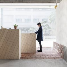 Hair salon in Osaka with diagonally striped wood and glass by Reiichi Ikeda.
