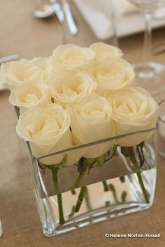 The perfect wedding centerpiece — Dollar Store square vases with 9 white roses each. Lauren, this will be gorgeous on those dark wine tablecloths you picked out. The perfect wedding… Mod Wedding, Wedding Table, Wedding Reception, Wedding Ideas, Reception Ideas, Trendy Wedding, Elegant Wedding, Wedding Simple, Wedding White