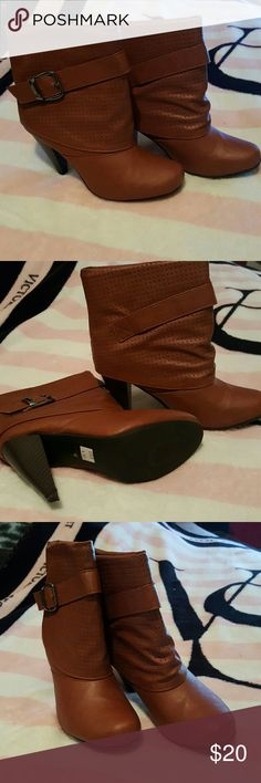 Brand new brown heel boots Brown color .. high heel .. never used ...De Blossom Collection brand ..  MAKE ME AN OFFER :) De Blossom Collection  Shoes Ankle Boots & Booties