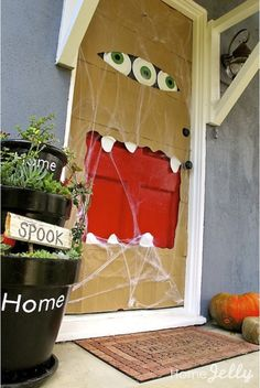 decorate your halloween door with paper bags i love the idea of the monster door - Cute Halloween Door Decorating Ideas