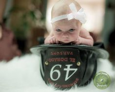 Shelli Sherwood photography. Baby Harper inside. Daddy's helmet