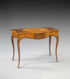 A very fine and well-proportioned George III inlaid satinwood side table, attributed to John Cobb, the serpentine and cross-banded top with a central oval cartouche banded in tulipwood and inlaid with a bouquet of flowers tied with a ribbon, all set in a flower head and trellis patterned ground, the serpentine apron defined by tulipwood cross-banding and further inlaid with a central oval, with the trellis pattern inside and flanked by swags of bell flowers Georgian Furniture, Antique Furniture, Furniture Decor, Furniture Design, Georgian Era, Trellis Pattern, Cabinet Makers, Entryway Tables, Apron