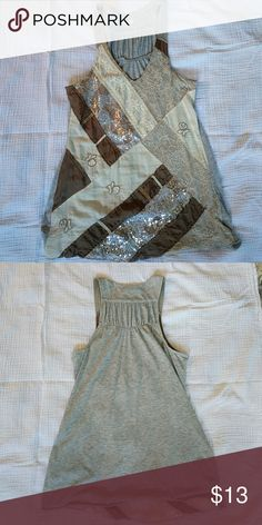 Anthropologie Jersey Knit Tank This tank from Anthropologie is extremely comfortable and so cute. Just the right amount of sparkle. Goes great with white jeans and some wedges. Anthropologie Tops Tank Tops