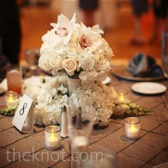 At the head table, Tia's bouquet (with the bridesmaid bouquets arranged around it) was the centerpiece.