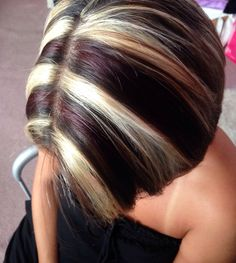 Chunky blonde highlights with red brown lowlights