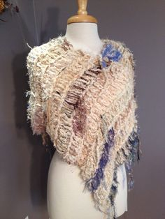 A personal favorite from my Etsy shop https://www.etsy.com/listing/246039879/hand-knit-fringed-shawl-shaggy-chic